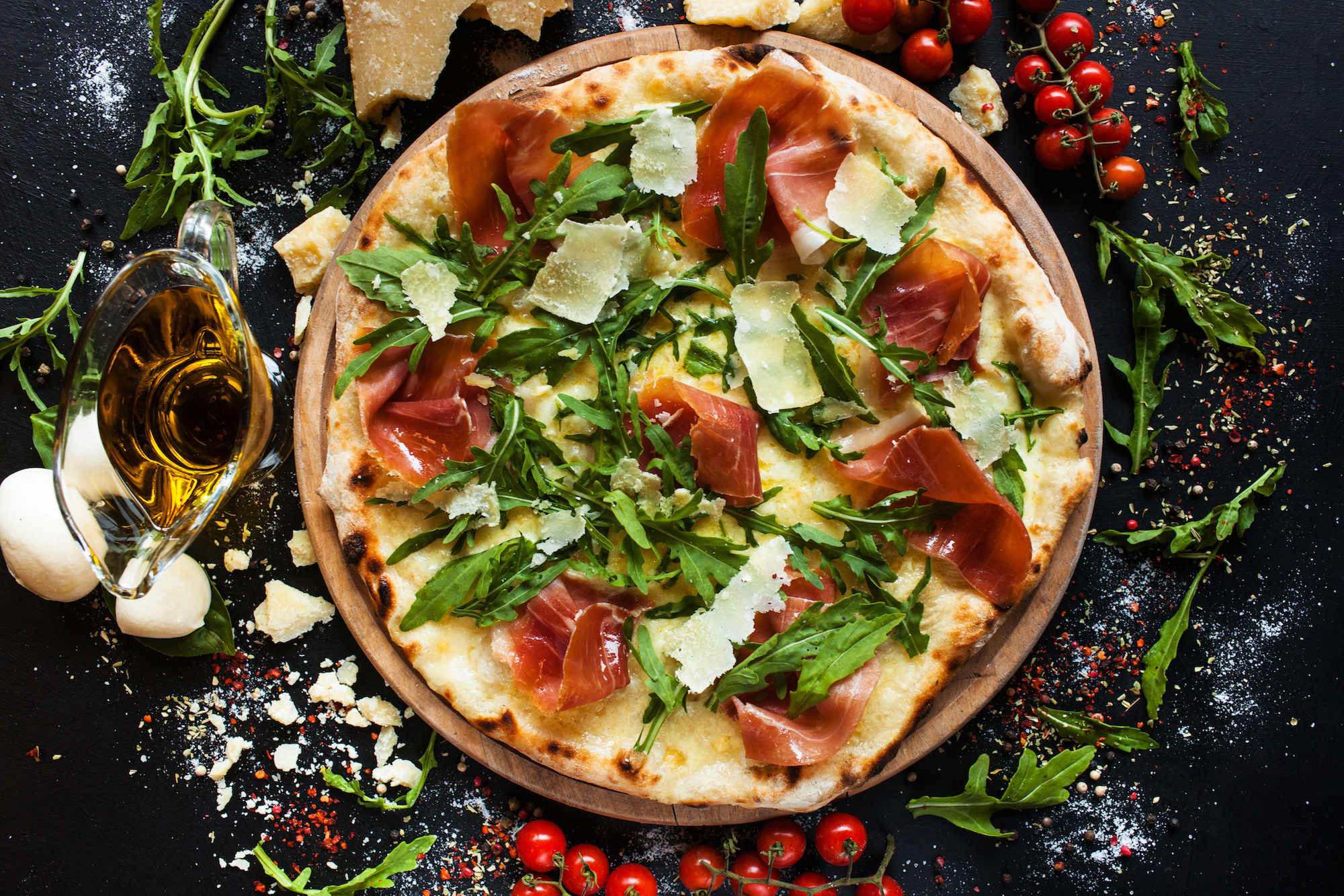 Salmon and arugula pizza. Light and tasty restaurant meal for a foodie