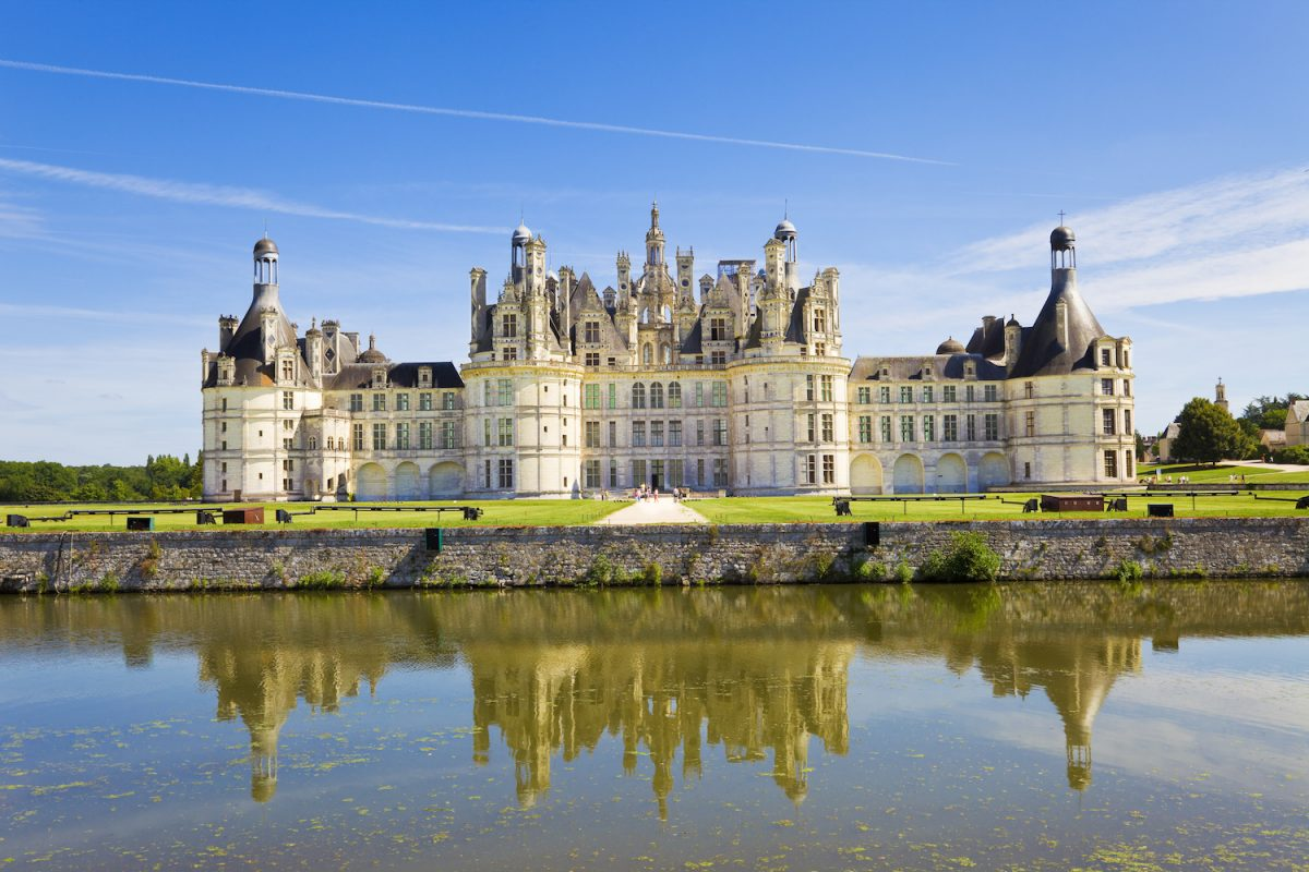 Chambord Chateau reflected in the canal. Panoramic view